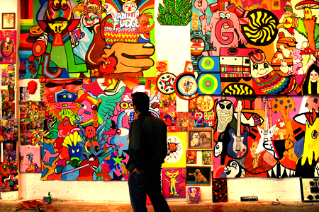 At an art show in the Miami Design District, a man looks at part of a huge, psychedelic, Pop Art installation created by a Miami art collective called DearRaindrop and exhibited as part of the 2004 Art Basel Miami Beach festivities.